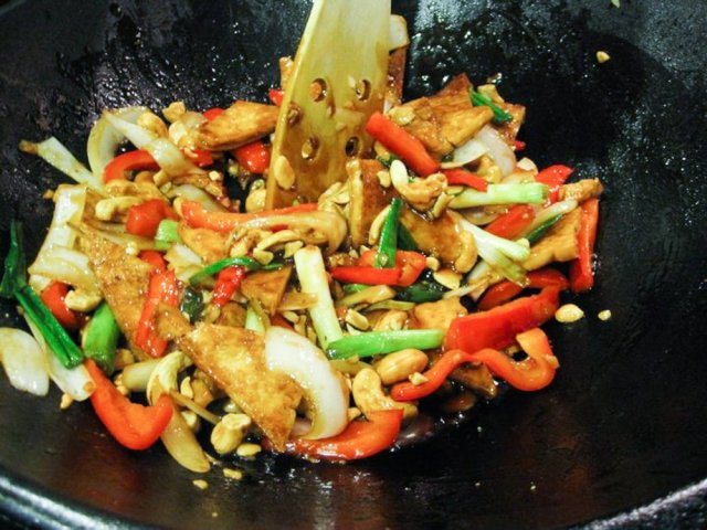 Easy Cashew Stir Fry Recipe - all the ingredients being stirred in the wok