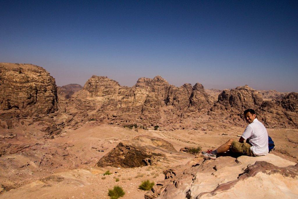 Halef sitting on a hill at Petra