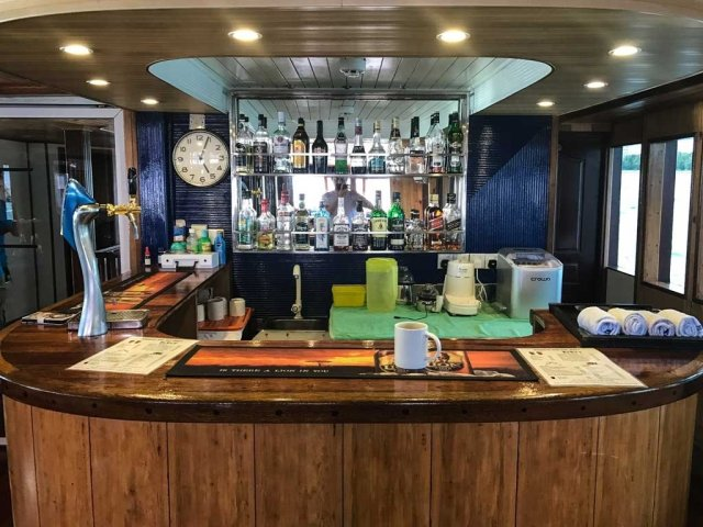 The bar aboard the Emperor Leo liveaboard. Fully stocked
