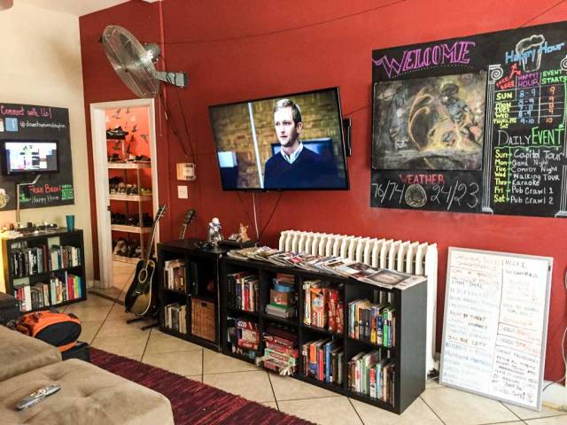 Downtown D.C. Hostel - The TV Room and Announcement board