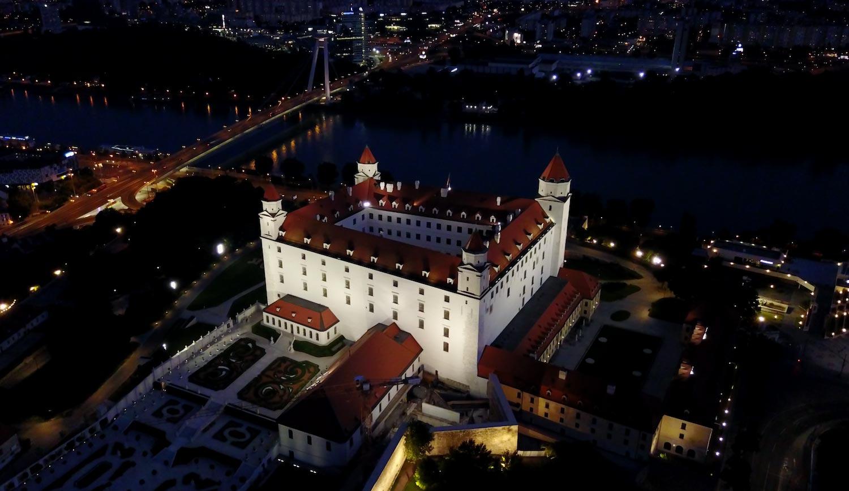 Drone's eye view of Bratislava castle at night.