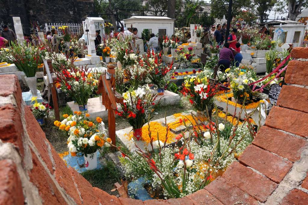 Cemetery in Mixquic decorated with marigolds and other colorful items