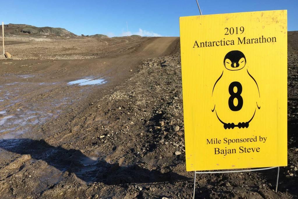 A yellow Antarctica Marathon 8 mile course marker