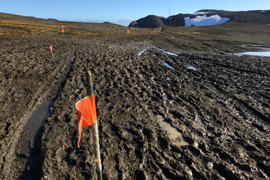 A photo of part of the antarctica marathon course showing deep mud and water puddles.