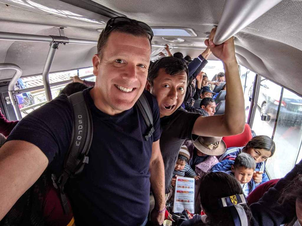 Michael and Halef on a very crowded bus in Cusco