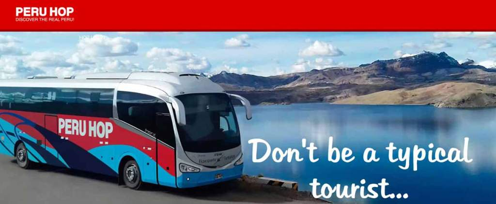 "Peru hop website banner with a bus and the line, ""Don't be a typical tourist"""