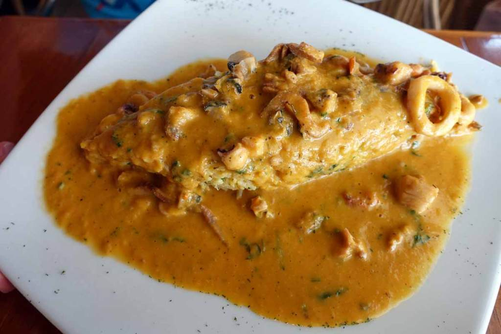 tacu tacu - a fritter-like concoction smothered in a yellow seafood sauce.