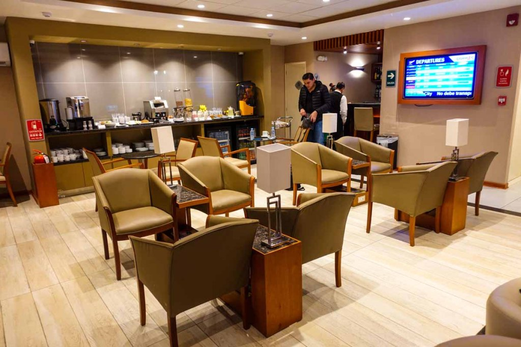 hanaq vip lounge wide angle view with man walking in with luggage