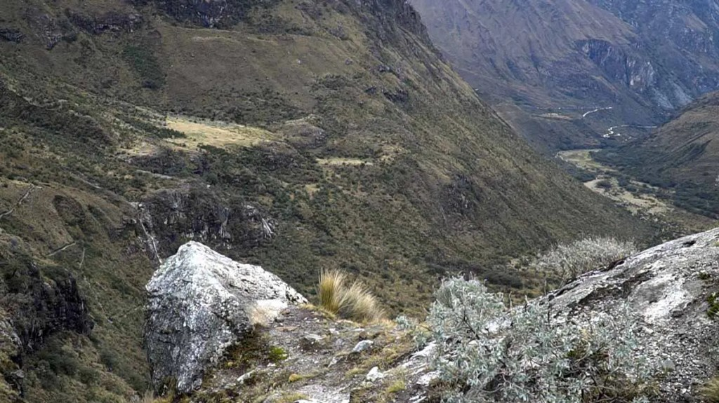 A view of the trek from about halfway up showing a distant valley below.