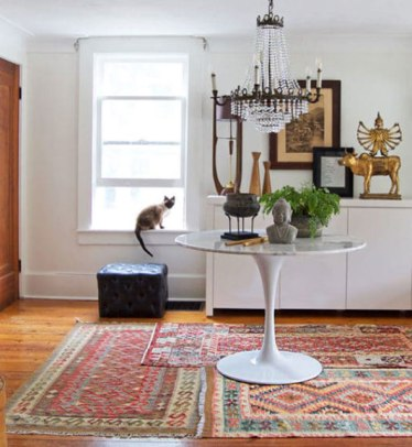 rug-layering-combo-tribal-rugs-from https://www.theartofdoingstuff.com/layering-patterned-rugs/