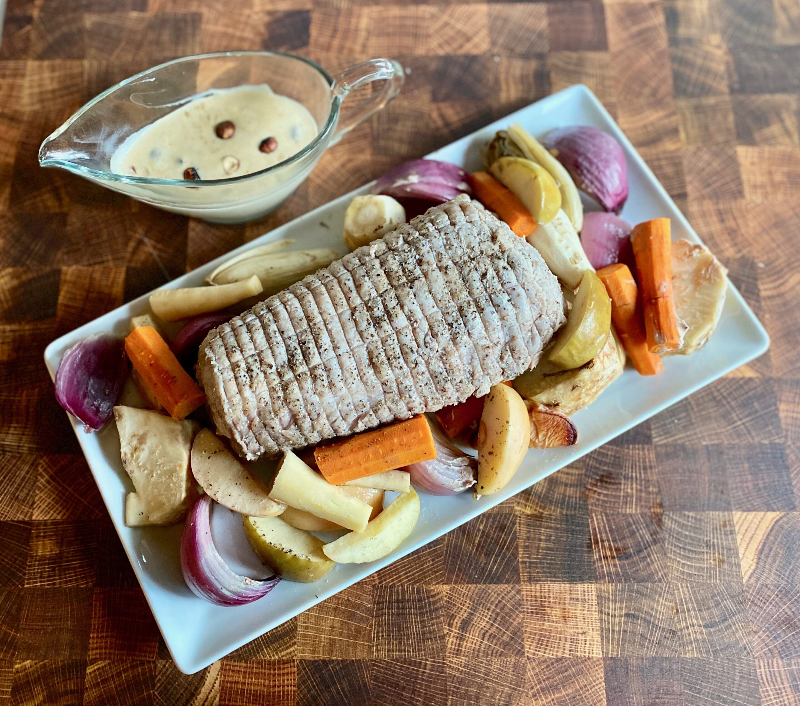 Slow Cooker Pork Roast with Apples and Root Vegetables and Hazelnut Sauce