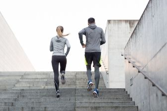 Two Runners Running Up Stairs