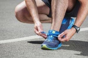 Runner Tying Shoes