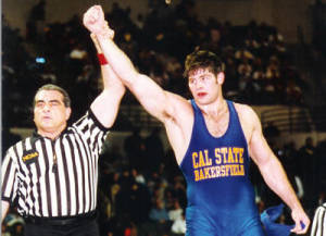 Stephen Neal gets his hand raised after a win. Neal wrestled at CSUB from 1996-1999. Photo from CSUB Athletics Department.
