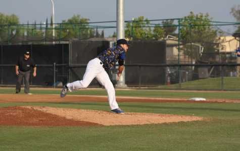 Hayden Carter, Senior, pitching to lead his team to victory on Friday, April 10 at Hardt Field. Karina Diaz/ The Runner