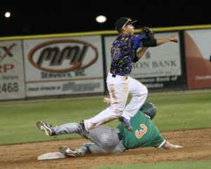 Sophomore David Metzgar jumps to avoid the sliding Texas Pan-American base runner to complete a 6-4-3 double play in the 9th inning.
