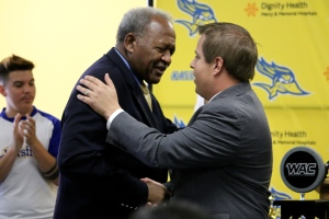 CSUB President Horace MItchell congratulates new Athletic Director Kenneth Siegfried during a press conference at the Icardo Room on Aug. 20.  Photo from Diana Olivares/ Athletics department