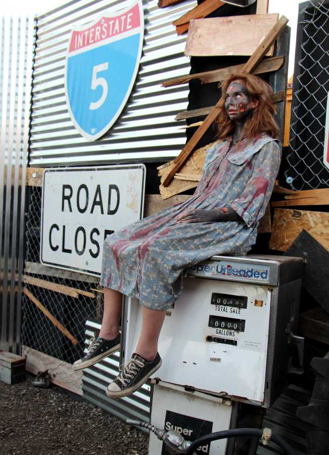 An actor sits in character as a zombie for the Talladega Frights horror attraction on Oct. 22.