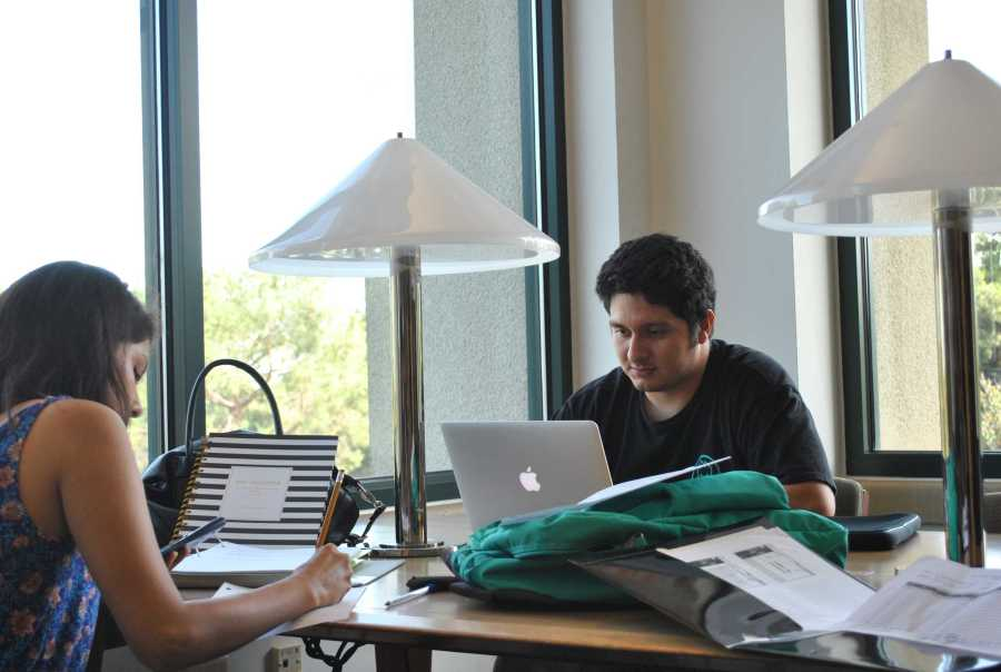 CSUB junior Itzi Andrade works on his laptop at the Walter Stiern  Library on Sept. 28. Photo by Graham C Wheat/The Runner