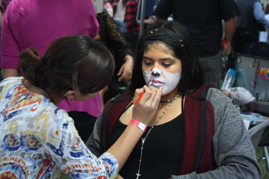 Community member Sylvia Luego gets her face painted on Sunday, Nov. 1 at the Bakersfield Museum of Art as part of the Dia de los Muertos festivities.