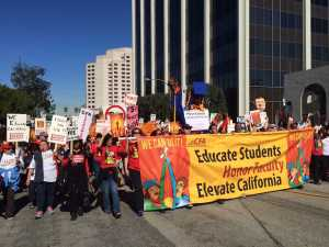 California Faculty Association members and supporters march to the Chancellor