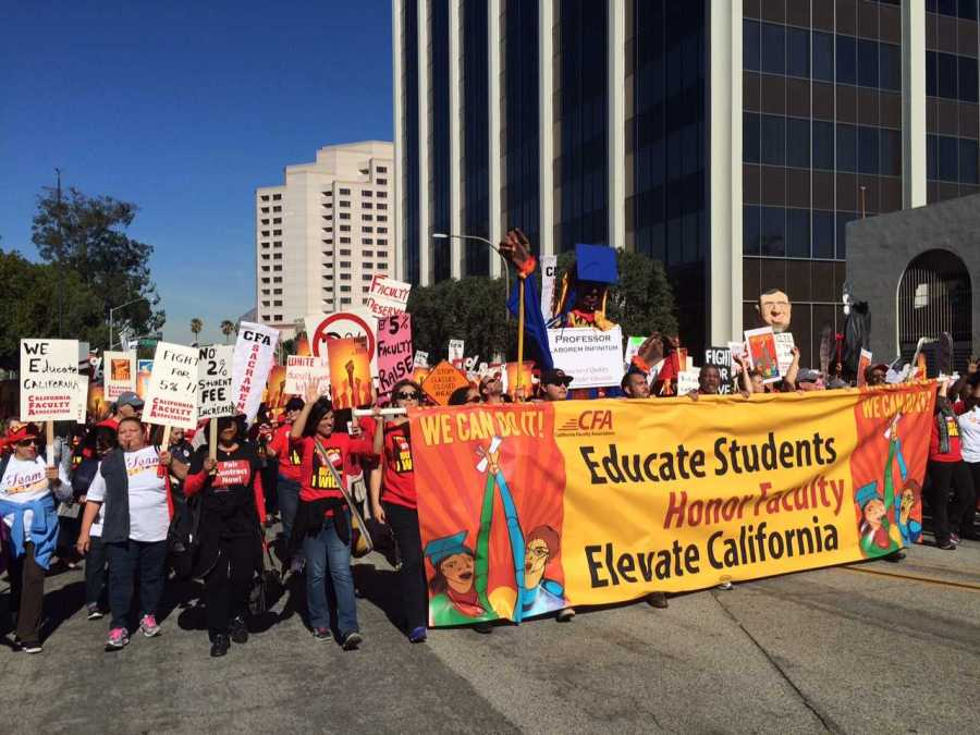 California Faculty Association members and supporters march to the Chancellor's office as part of their