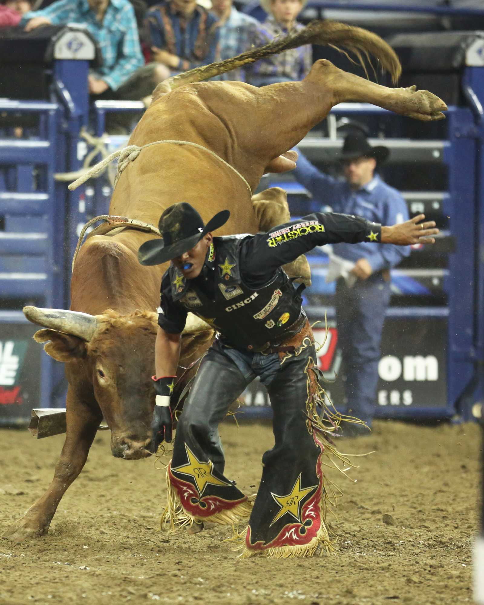 After getting off Slingin It Valdiron de Oliveira looks for safety as he tries to avoid the bull.