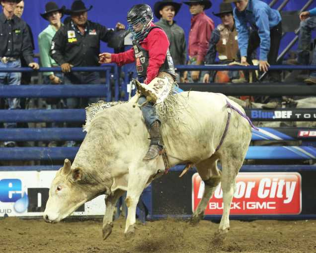World Champion rider Mike Lee rides the bull he drew for the final rounds which put him atop the leader board but it would not hold on as he would end the night in second place.