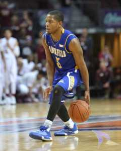 CSUB junior guard Dedrick Basile dribbles the ball between his legs during the game against New Mexico State in Orleans Arena. Photo by AJ Alvarado/The Runner
