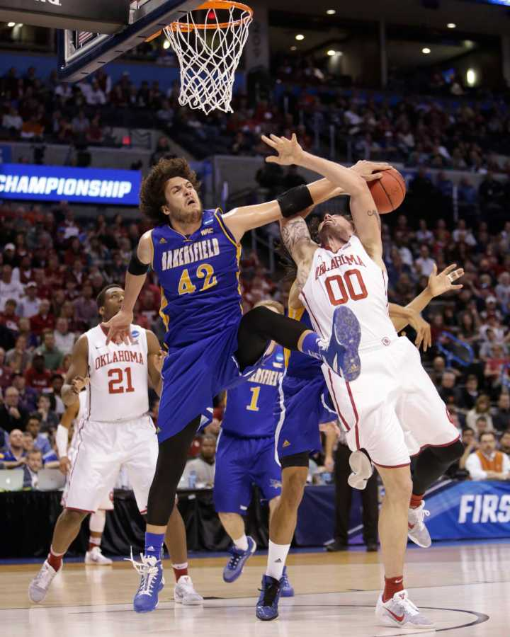 CSUB%27s+Aly+Ahmed+blocks+Oklahoma%27s+Ryan+Spangler+shot+during+Friday%27s+NCAA+Division+I+Men%27s+Basketball+Tournament+first+round+game.%0APhoto+by+AJ+Alvarado%2FThe+Runner
