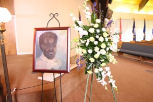 A portrait of Solomon Ogbede Iyasere created by one of his students as a gift for his family adorned the memorial service on April 9. Photo by Alejandra Flores/The Runner