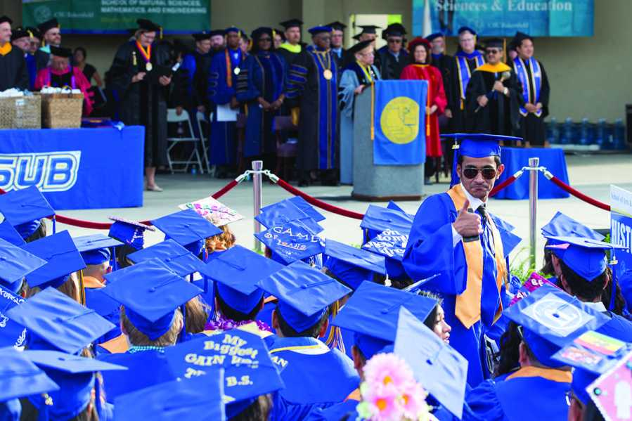 A graduate poses as the ceremonies begin at the CSUB Amphitheater on June 10. Photo by Ben Patton/The Runner