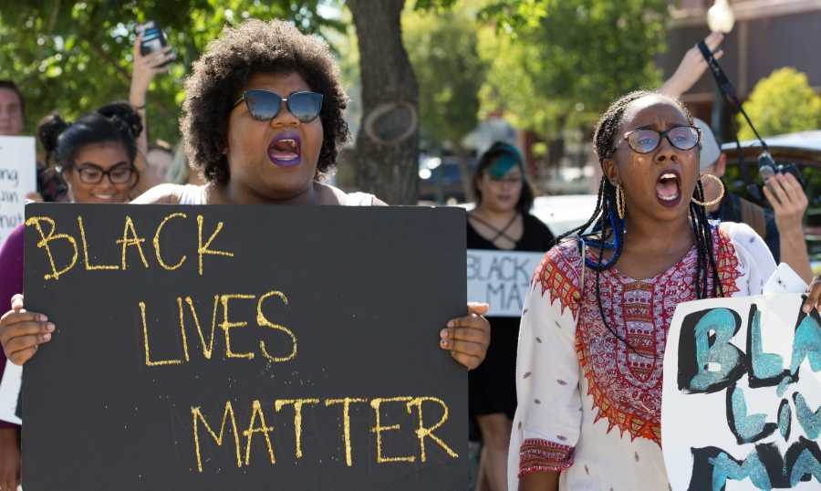 Participants of the Black Lives Matter peaceful protest march and chant in downtown Bakersfield on Saturday, July 9. Photo by Ben Patton/The Runner