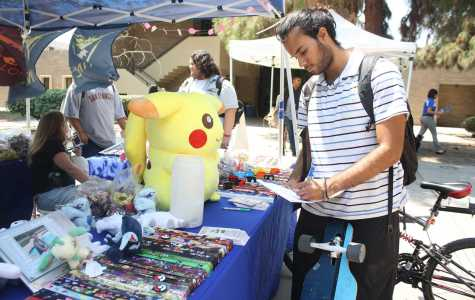 Computer science major Cesar Loya signing up for campus gamers at the club fair on Friday, August 26. By Karina Diaz/The Runner