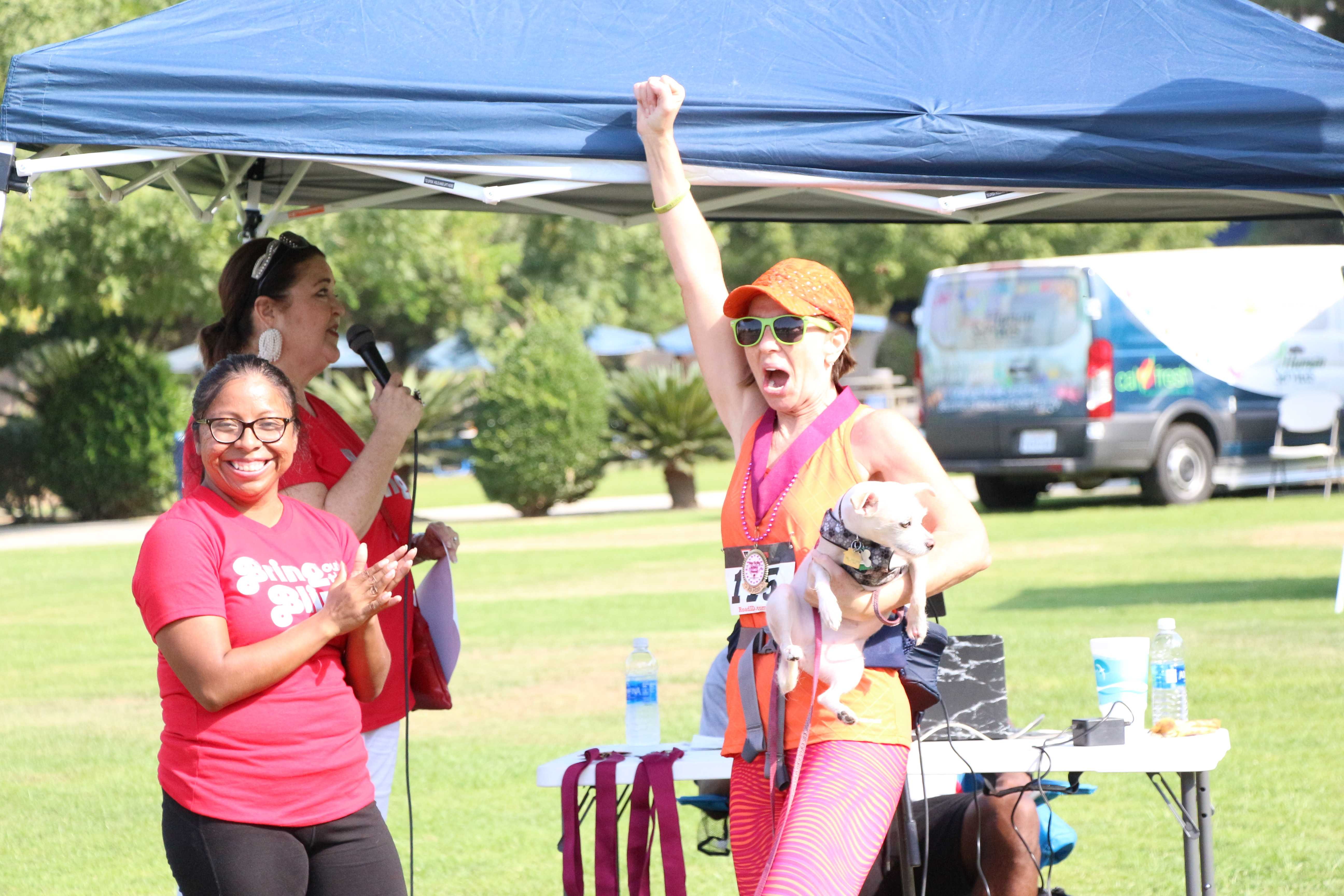 Sara Danville won first place in her age group at the Bring out the Bling 5K Fun Run benefitting Dress for Success Bakersfield at CSUB on Saturday. Photo by Alejandra Flores/ The Runner