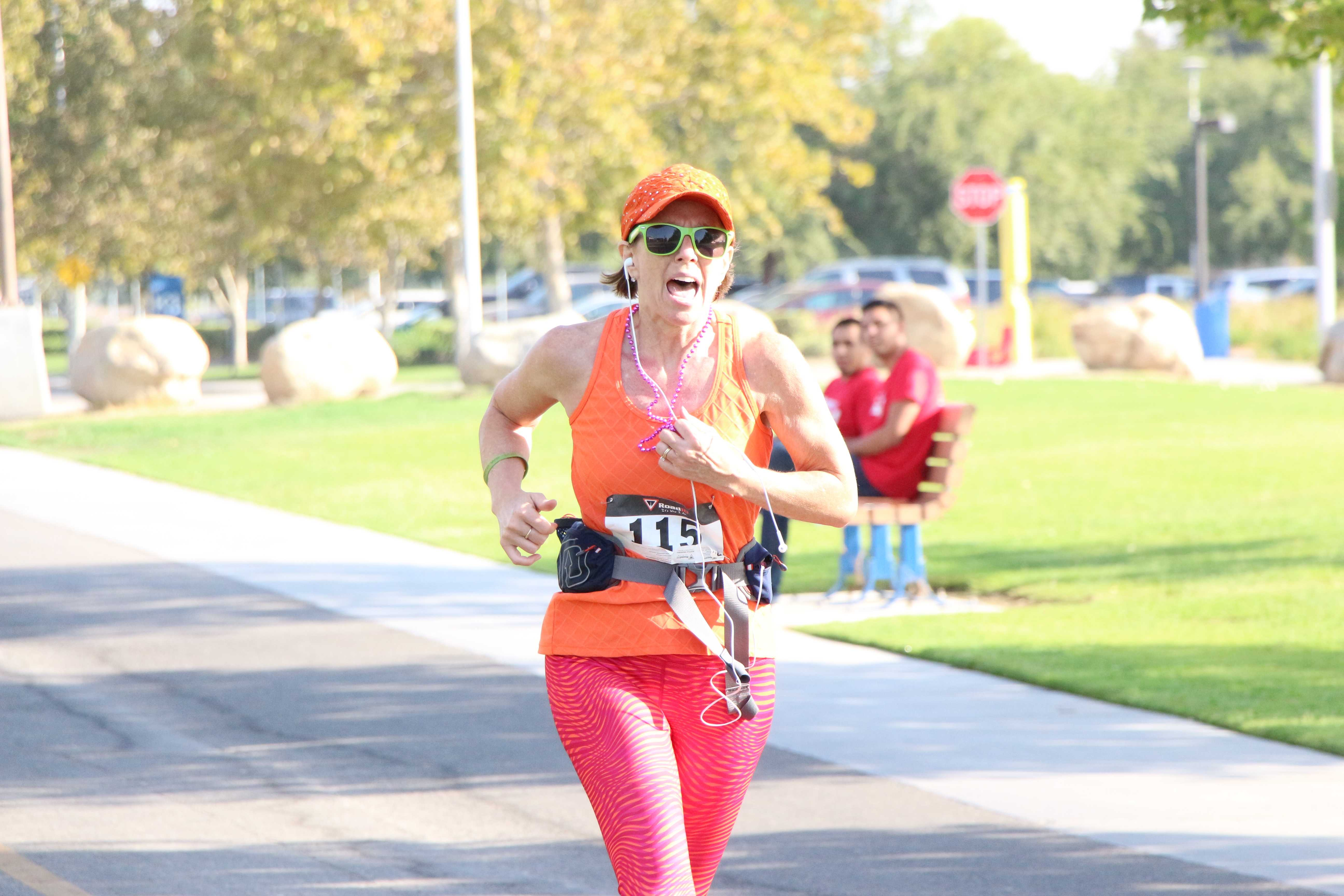 Sara Danville seconds away from crossing the finish line for the Bring out the Bling 5K Fun Run benefitting Dress for Success Bakersfield at CSUB on Saturday.  Photo by Alejandra Flores/ The Runner