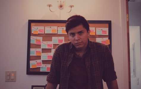 A profile picture of Mark Federico Moreno, standing in front of his script board. Picture courtesy of Mark Moreno. Taken October 1, 2016.