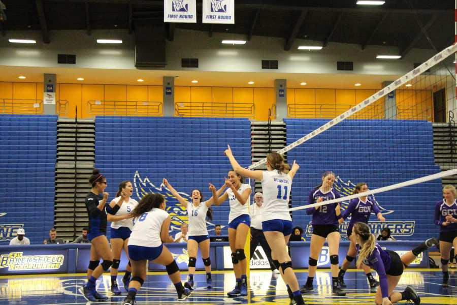 The Roadrunners celebrate a win against UTRGV on May 2 after losing three straight set against New Mexico State.