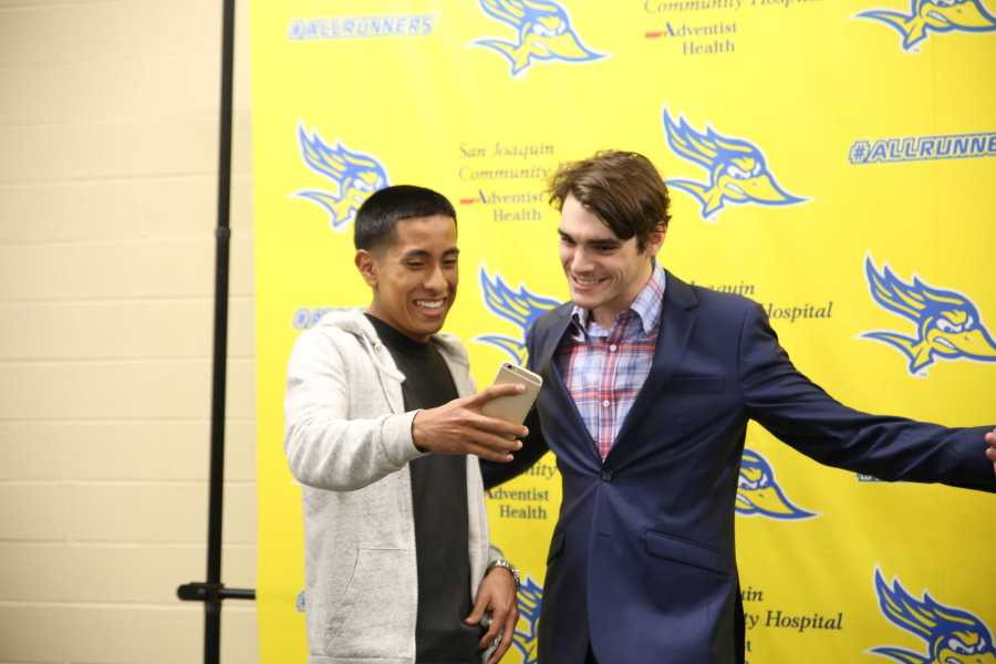 Mechanical engineering major Sergio Mejia facetime one of his friends in the meet and greet with RJ Mitte on Sunday, Oct. 24 By Karina Diaz/ The Runner