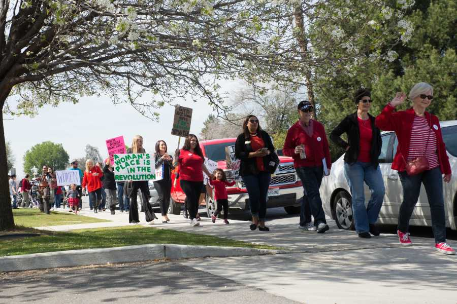 Marchers walk down the streets of downtown Bakersfield in support of womens rights Wednesday, March 8. Photo by AJ Alvarado/The Runner