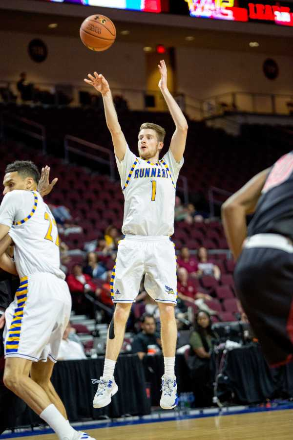 Redshirt-junior Brent Wrapp attempts a shot against New Mexico State at the Orleans Arena in Las Vegas Saturday, March 11. Photo by AJ Alvarado/The Runner