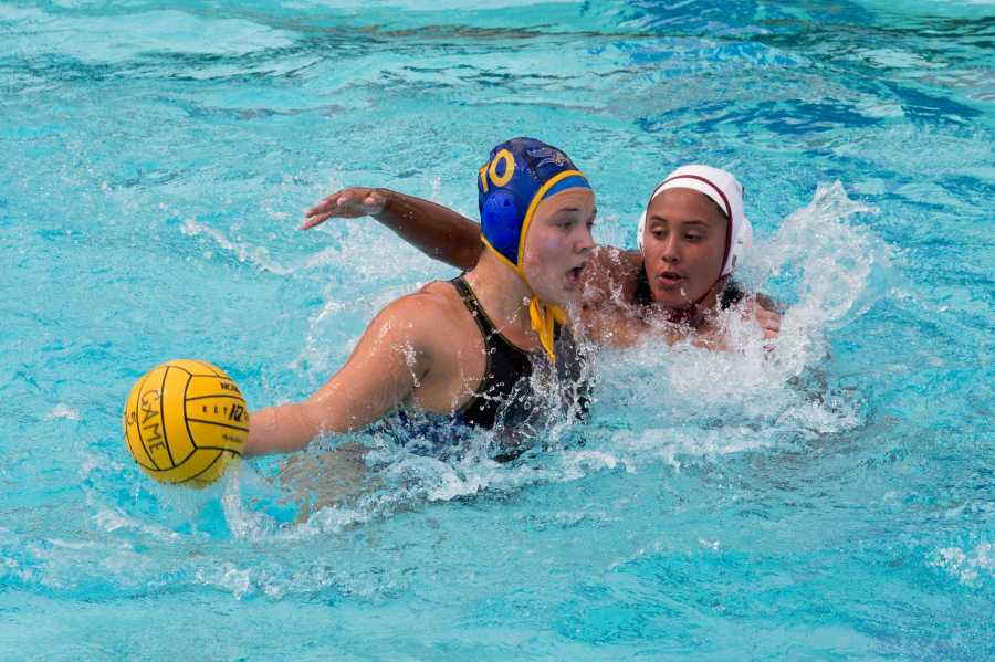 Junior utility player Cassandra Ream drives past an Arizona State defener in a game at Hillman Aquatic Center on Saturday, March 18.