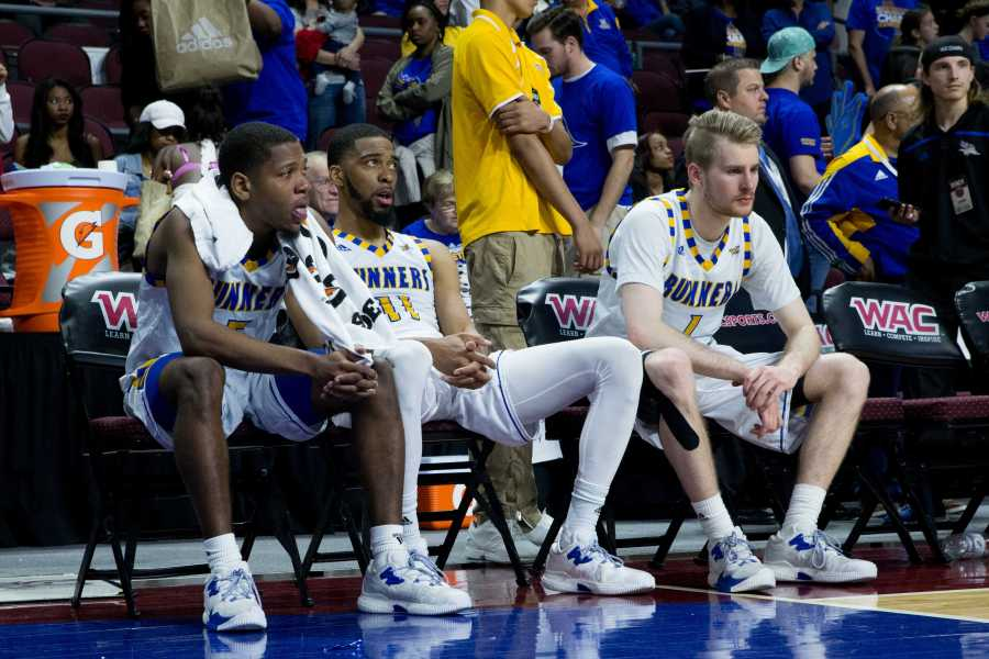 From left to right: CSUB senior Dedrick Basile, redshirt-senior Jaylin Airington and redshirt-junior Brent Wrapp look on in the final moments of the game against New Mexico State at the Orleans Arena in Las Vegas Saturday, March 11.