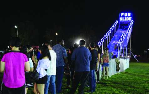 Students line up for a turn flying down the Fun Slide during Runner Nights at CSUB Sept. 8.  Photo by Skylar Carrasco/ The Runner