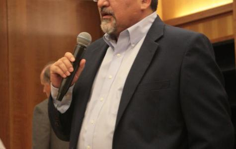Professor Mark Martinez addressed the crowd in the Dezember reading room on Oct. 19, Martinez spoke about immigrant rights at the screening of
