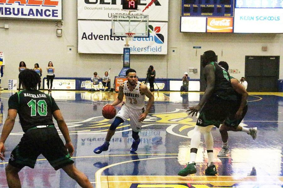 CSUB's, Damiyne Durham, #23. fends off three Utah defenders, on Thursday, Feb. 22 in the Icardo Center.  Photo: Aaron Mills