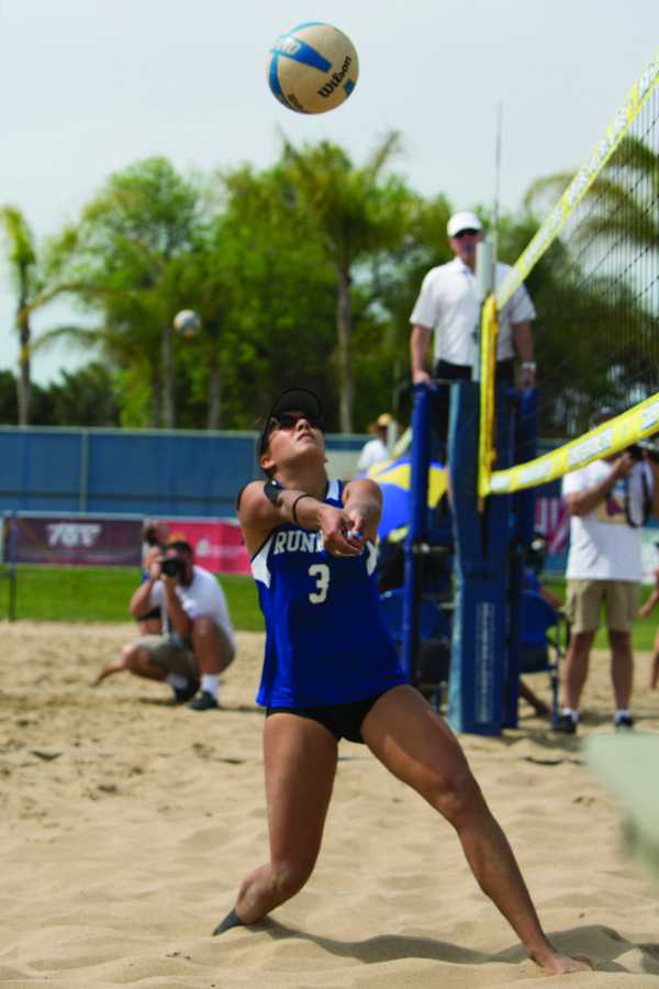 Senior Emily Lopes prepares to hit the volleyball during the 2017 season.  Runner Archives