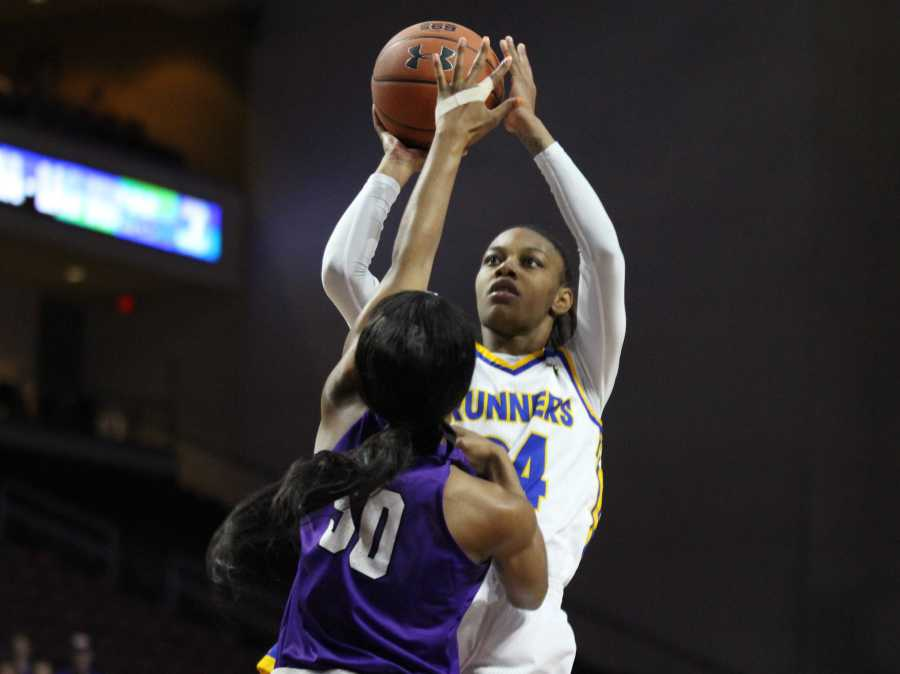 Senior forward Aja Williams rises for a jump shot over Myra Willaims of Grand Canyon in the WAC tournament semifinals on Friday, March 9 at the Orleans Arena in Las Vegas. Photo: Vincent Perez