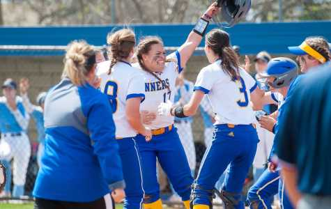 Paige Johnson (center) celebrates with teammates after her walk-off base hit against San Diego on  Saturday, March 17 at the Roadrunner Softball Complex. They won 2-1 in 8 innings to snap their 8-game losing streak.  Photo: gorunners.com