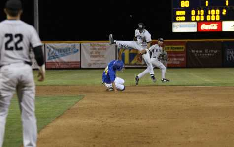 Mark Pena, CSU Bakersfield redshirt-senior, slides into second base under New Mexico State second baseman Nick Gonzales at Hardt Field on Friday, April 6. CSUB lost to NMSU 9-3.  Photo by Ricky Gonzales/ The Runner